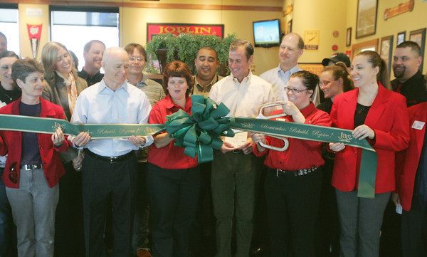 Globe/Roger Nomer<br /> The ribbon is cut for the grand reopening of the Range Line Pizza Hut on Friday morning.