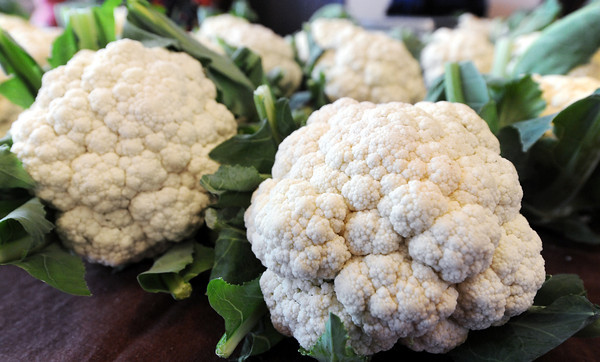 Globe/T. Rob Brown<br /> Cauliflower grown by Tom Lewis, of Stockton, and Broken Wire Ranch, for sale at the Webb City Farmers Market Friday morning, April 20, 2012.