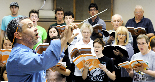 """Globe/T. Rob Brown<br /> Director David Sharlow leads a practice for Handel's """"Messiah"""" Wednesday night, April 11, 2012, in MSSU's choir room."""