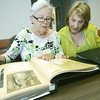 Globe/Roger Nomer<br /> Joy Cragin, left, and Maridan Kassab look through a scrapbook of past St. Avips fundraisers.