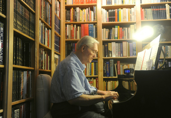 """Globe/Roger Nomer<br /> Hubert Bird plays a selection from """"The Other Side of Storm"""" on Thursday afternoon."""