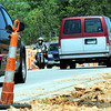 Globe/T. Rob Brown<br /> Motorists travel north and south on North Main Street Thursday, April 19, 2012, in single lanes near the intersection with Zora, where construction workers are building an overpass.