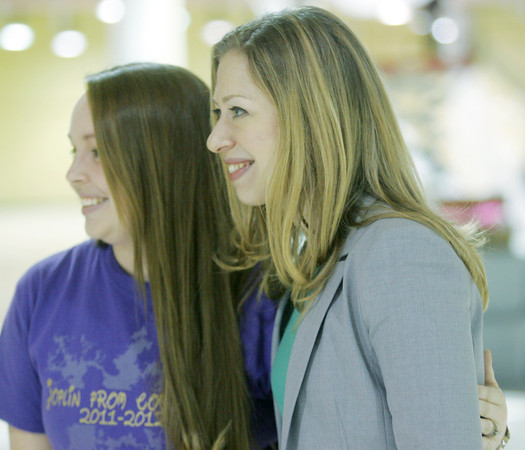 Globe/Roger Nomer<br /> Chelsea Clinton poses for a photo with Joplin High teacher Amber Travis on Friday afternoon.  Clinton was in town filming a segment for the NBC Nightly News about the prom.