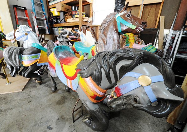 Globe/T. Rob Brown<br /> A variety of carousel horses painted by Ed Hardesty, of Carthage, Tuesday morning, April 17, 2012, in Carthage.