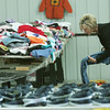 Globe/Roger Nomer<br /> Carol Brockman, volunteer coordinator for the Salvation Army, folds clothing on Thursday morning.