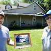 Globe/T. Rob Brown<br /> Tom Duane Scott, left, holds a photo of what the Scott family home looked like from 1935 to 2001 as he stands next to his father, Bill Scott, on the property near Parsons, Kan., Wednesday afternoon, April 25, 2012. In 2001, the property was remodeled and 1,600 square feet were added. Six generations have lived on the property.