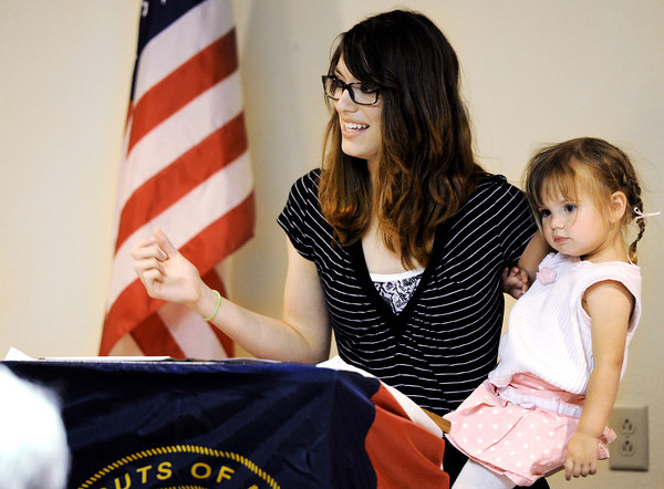 Globe/T. Rob Brown<br /> Courtney Grisham, of Greenfield and formerly of Joplin, holds her 2-year-old daughter Emily Grisham as she speaks to a group of Boy Scouts of America representatives and supporters Tuesday during a luncheon, April 17, 2012, at Granny Shaffer's Banquet Hall on North Range Line Road in Joplin. Grisham told her experiences from May 22, 2011, at St. John's Regional Hospital (now Mercy) and the brave and helpful actions of Eagle Scout Matt Hutchison, of Joplin.