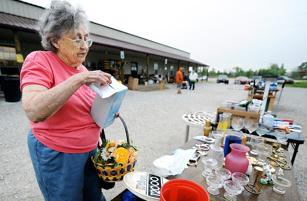 Globe/T. Rob Brown<br /> Betty Magers, of Joplin, looks through items in the Habitat for Humanity ReStore's yard sale Saturday morning, April 7, 2012.