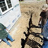 Globe/T. Rob Brown<br /> Larry Jump, left, speaks to volunteer Wilmer Faber, right, and the Rev. Sam Krikke, next to right, of Inwood (Iowa) Christian Reformed Church Friday afternoon, April 6, 2012, at the Jump family's Joplin home. The church group was volunteering through Catholic Charities, which has been helping the Jumps finish their home.