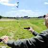 Globe/T. Rob Brown<br /> Virgil McCoy, of Joplin, test flies a stunt kite Monday afternoon, April 23, 2012, in a field at Missouri Southern State University. McCoy said the kite-worthy wind would come and go. Temperatures dipped down below 40 in the morning to be much cooler than recent weeks.
