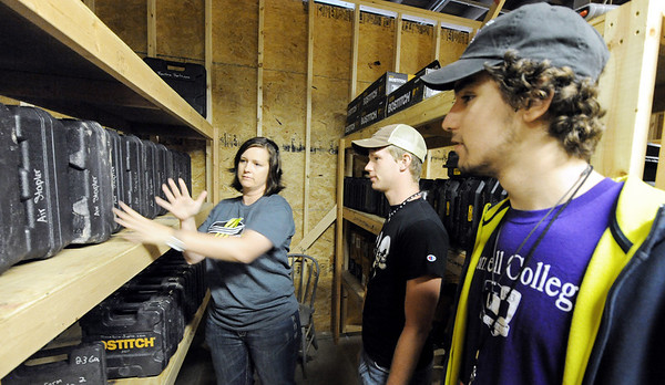 Globe/T. Rob Brown<br /> Amy Ipsen, Transform Joplin volunteer and co-owner of the warehouse with her husband, shows construction gear to volunteers Logan Schultz, right, and John McElroy, both Cornell College students from Mt. Vernon, Iowa, as they prepare to go out for tornado recovery efforts Monday morning, April 2, 2012. The group of about 17 students were here as part of their college's Alternative Spring Break project.
