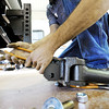 Globe/T. Rob Brown<br /> Nick Pickrell, service technician, of La Russell, adds a trailer hitch onto a customer's pickup truck Wednesday afternoon, April 18, 2012, at Wheelen RV Center, 4301 Range Line Road, Silver Creek.
