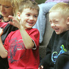 Globe/Roger Nomer<br /> Brayden Johnson, left, and Gabe Williams, both 5 years old, sing a silly song during story time at the Joplin Public Library on Thursday morning.