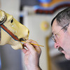 Globe/T. Rob Brown<br /> Ed Hardesty, of Carthage, paints a carousel horse Tuesday morning, April 17, 2012, in Carthage.