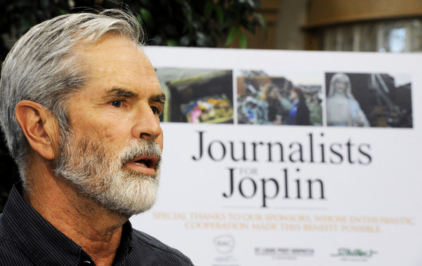 Globe/T. Rob Brown<br /> J.B. Forbes, chief photographer for the St. Louis Post-Dispatch, donates a series of 19 photo enlargements, size 20-by-30, shot by him and his staff, to the city of Joplin Friday afternoon, April 27, 2012, at Joplin City Hall. A group of 44 images were part of the Journalists for Joplin effort where photos were sold through silent auction to raise funds for Joplin Tornado First Response Fund. Of those 44 images, 19 were donated back by the auction winners to be given to the city of Joplin.