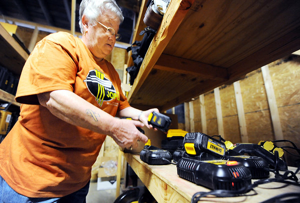 Globe/T. Rob Brown<br /> Sandy King, a Transform Joplin volunteer and tool crib supervisor, checks in a battery-powered drill at the tool crib, inside the warehouse owned by Amy Ipsen and her husband to prepare the gear for the next group that will use the equipment for tornado recovery efforts Monday morning, April 2, 2012.