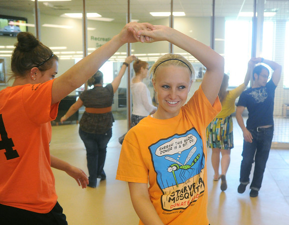 Globe/Roger Nomer<br /> Missouri Southern freshmen Amber Varner, left, and Taylor Utt practice their salsa dancing during a Diversity Week event at Billingsly Student Center on Tuesday afternoon.