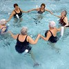 BEN GARVER – THE BERKSHIRE EAGLE<br /> At 90, Theresa Tracy teaches an Aquafit class at the YMCA in Pittsfield.  The classes are open to anyone Monday, Wednesday and Friday 11am-noon.  Theresa's birthday was Tuesday and she has been teaching fitness for 22 years at the YMCA after a career as a nurse.
