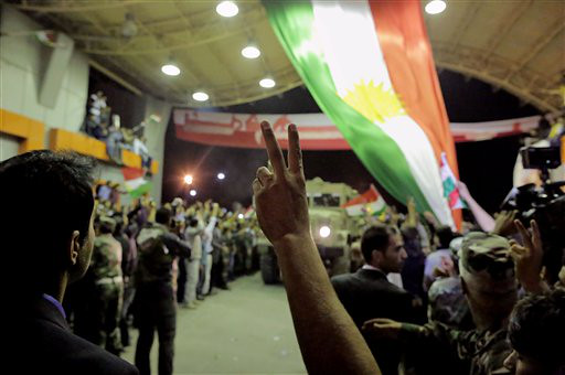 1. IRAQI KURDS HEAD TO FIGHT MILITANTS IN SYRIA