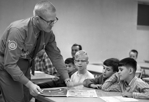 THE GOSHEN NEWS | October 1, 1968<br /> Francis Gardner of St. John's Catholic Church Pack 89, shows three interested young boys a copy of Boys Life, the official scouting magazine. The boys are, left to right, Joe Gerwels, age eight, Luis Perez, seven, and Felix Henandez, 10. The annual School Night of Scouting was held throughout the Pioneer Trails Council Monday night.