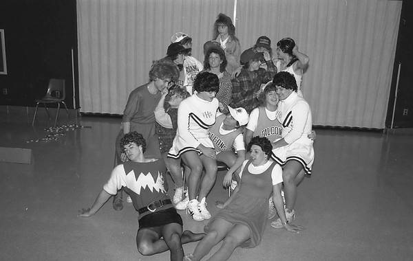 THE GOSHEN NEWS | 2-27-90<br /> Students do strange things to raise school spirit during sectional week – like wer eachothers clothes. The girls and guys decided to swap apparel Monday, just one of the dress-up days planned this week at Fairfield High School. Showing off their new looks are, in front, from left, Andre Fisher and Kendon Troyer. In the second row are Jeff Kitson, Angela Mast, Jonathan Allison, Dori Umbower, Beth Doane and Bill Dunlap. In the third row are Lisa Winkler, Juli Johnson, Julie Juif and Lawrence Yoder. In the back are government teacher Marty Cesco, Carrie Tidwell and Lisa Coil.