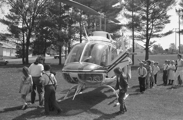 THE GOSHEN NEWS | May 14, 1988<br /> A different type of vehicle landed on the lawn at Millersburg Elementary School as students got a chance to check out one of the Indiana State Police helicopters. Sgt. Barry Black, brother-in-law of kindergarten teacher Dian Black, explained to students how the helicopter works and how the police use it to transport people, search for lost people and perform rescues.