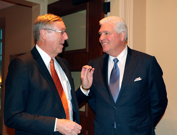 SHERRY VAN ARSDALL | THE GOSHEN NEWS Elkhart County Circuit Court Judge Terry Shewmaker talks with Indiana Court of Appeals Judge John Baker at the Lerner Theatre during a retirement party.