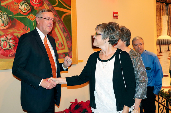 SHERRY VAN ARSDALL   THE GOSHEN NEWS Elkhart County Circuit Court Judge Terry Shewmaker greets his administrative assistant, Cheryl Jackson, at the Lerner Theatre during a retirement party.