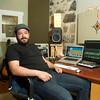 SAM HOUSEHOLDER | THE GOSHEN NEWS<br /> Joel Jimenez sits in his sound studio space in Goshen Friday. Jimenez will be running the soundboard for Jewel for several California tour dates next month.
