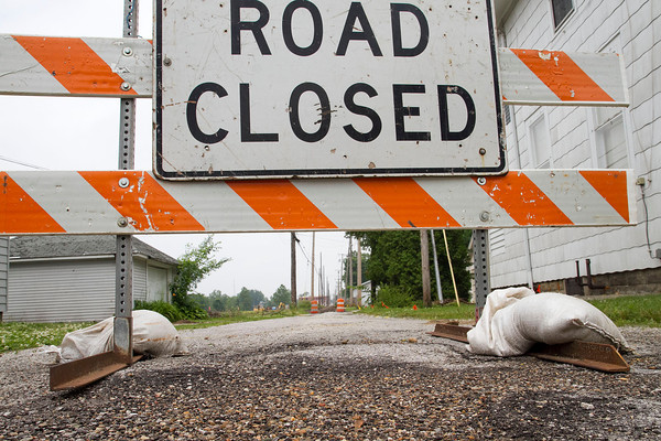 SAM HOUSEHOLDER | THE GOSHEN NEWS<br /> A road closed sign is shown at the alley off of Douglas Street in Goshen Friday. The alley is being expanded into a street and will be named River Race Drive.