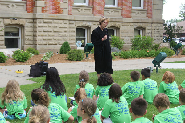 SHERRY VAN ARSDALL | THE GOSHEN NEWS<br /> Magistrate Deborah Domine tells fourth-to-sixth grade students about the juvenile justice system at the Elkhart County Courthouse during the 2014 C.L.A.S.S. Student Leadership Summit Tuesday.