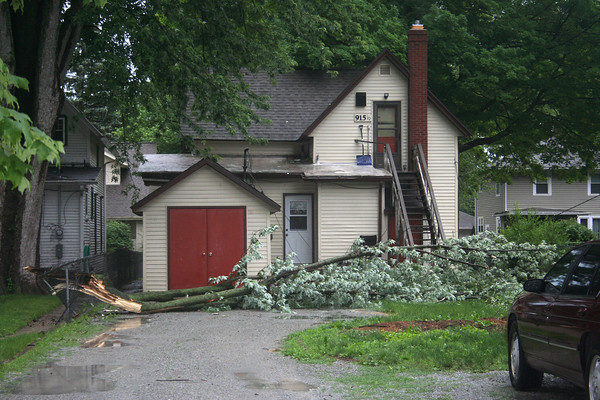 SHERRY VAN ARSDALL   THE GOSHEN NEWS<br /> A tree limb lays across the yard of a property in the 900 block of South Eighth Street Wednesday afternoon.