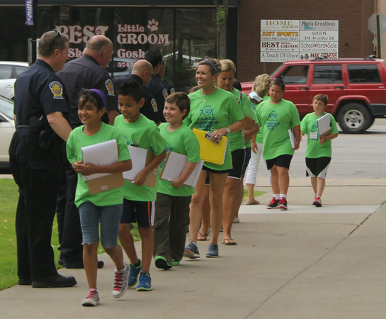 SHERRY VAN ARSDALL | THE GOSHEN NEWS<br /> Fourth-to-sixth grade students shook hands with Goshen police and firefighters at the Elkhart County Courthouse during the 2014 C.L.A.S.S. Student Leadership Summit Tuesday.