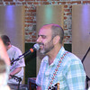 "MICHAEL WANBAUGH | THE GOSHEN NEWS<br /> Moe. band member Al Schneier performs for fans Wednesday evening at Ignition Music Garage in downtown Goshen. The nationally-recognized jam band released a new album, ""No Guts, No Glory"" May 27."