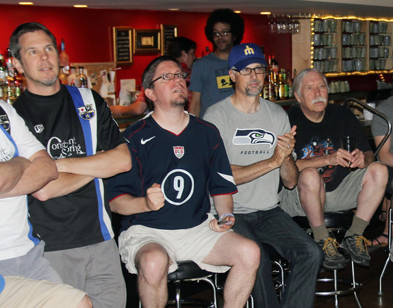 JOHN KLINE | THE GOSHEN NEWS<br /> U.S. soccer fans react to a just-missed goal by the USA during the USA versus Portugal World Cup game at Constant Spring in downtown Goshen Sunday evening.