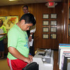SHERRY VAN ARSDALL | THE GOSHEN NEWS<br /> Sixth-grader Yanni Romero tries a manual typewriter in the newsroom at The Goshen News during the 2014 C.L.A.S.S. Student Leadership Summit Tuesday.