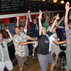 MICHAEL WANBAUGH | THE GOSHEN NEWS<br /> Fans of the United States' World Cup soccer team celebrate at the Constant Spring in downtown Goshen after the U.S. took a 2-1 lead late in its game Sunday with Portugal. The Constant Spring is normally closed on Sundays, but opened for soccer fans to watch the U.S. game, which was played in Brazil. The reaction was much more somber several minutes later when Portugal scored on a header in the final moments to force a draw. Read about Sunday's World Cup games on B1