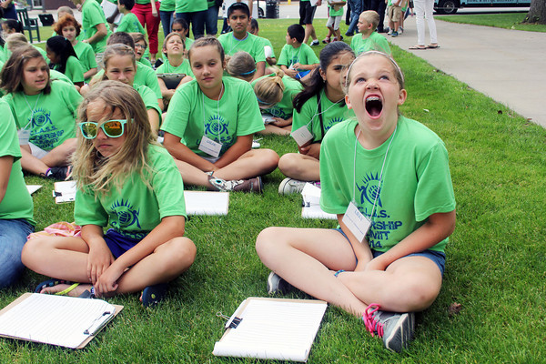 SHERRY VAN ARSDALL | THE GOSHEN NEWS<br /> At right, fifth-grader Lilly Schackow yawns while waiting for the first speaker at the Elkhart County Courthouse during the 2014 C.L.A.S.S. Student Leadership Summit Tuesday.