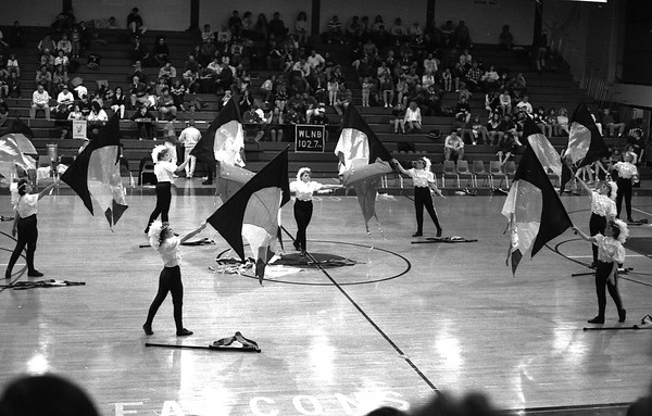 THE GOSHEN NEWS PHOTO  THE GOSHEN NEWS | FEB. 22, 1992<br /> The Fairfield High School winter guard performs during halftime at the boys basketball game against West Noble Friday night. The winter guard, consisting of the flag corps from the marching band, performs choreographed routines to recorded music using flags and other props. A winter guard contest will be held next Saturday at NorthWood High School.