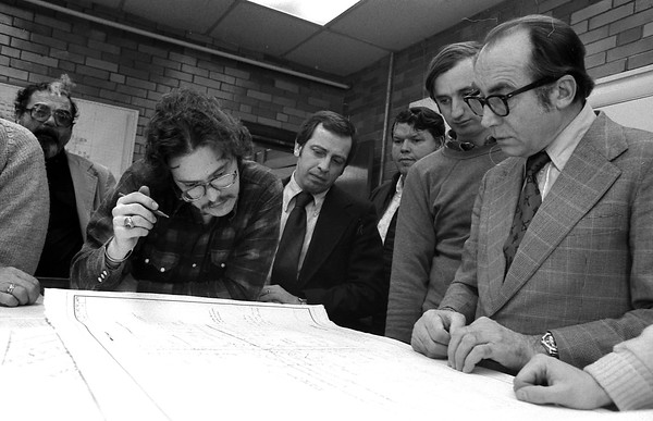 THE GOSHEN NEWS PHOTO  THE GOSHEN NEWS |  FEB. 8, 1980<br /> Elkhart Count commissioners and Goshen mayor Max Chiddister met with officials of the Indiana State Highway Commission and federal highway administration as the consulting engineers explained preliminary plans for the Goshen railroad overpass Thursday. At right is Henry Novickas, project engineer, with Murphy Engineering, Chicago, Ill., as others look on the plans for the road. The plans are about 30 percent complete. At far left is Commissioner Hal Dorlot and at center is Mayor Chiddister.