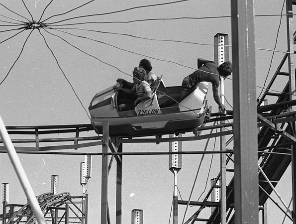 THE GOSHEN NEWS PHOTO  BACK WHEN JULY 20, 1979<br /> Workers for Gooding's Million Dollar Midways are shown working on Zykion, one of the world's largest poortable roller coasters. This crew was oiling and testing the track. Gooding's employees have been at the fairgrounds all week setting up rides and attractions in preparation for today's opening. The fair is scheduled to run through Saturday, July 28.