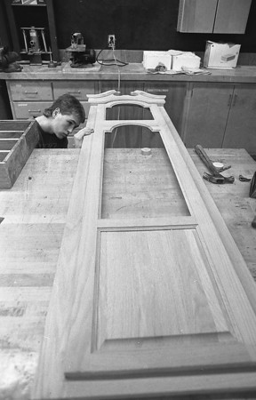 THE GOSHEN NEWS PHOTO  BACK WHEN May 11, 1989<br /> Brendan Yoder, a senior in the advanced woods class at Fairfield puts the finishing touches on the door of a grandfather clock in preparation for Saturday's Creative Arts Festival.