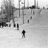 THE GOSHEN NEWS PHOTO  THE GOSHEN NEWS |  Dec. 28, 1981<br /> Snowfall records for Goshen were broken last week and Sunday as about 25 inches of snow has fallen here so far this month. Even with packing and melting, there is officially 10 inches of snow on the ground at Goshen. Ski areas have been busy places as enthusiasts from several states around the area have visited Mt. Wawasee ski resort the past two weeks. A good crowd visited the resort over the weekend as temperatures near the freezing mark made snow slick for skiiers. Above skiiers use two tow systems to get up the north slope at the New Paris resort Sunday.