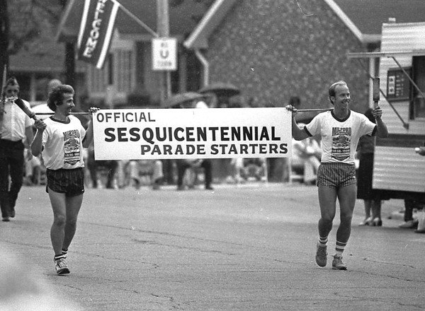 THE GOSHEN NEWS PHOTO  BACK WHEN June 8, 1986<br /> Leading the entire parade with this banner were Homer Miller, left and Richard Rhodes, the torch bearers for the Saturday Milford Sesquicentennial parade.