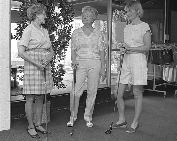 """THE GOSHEN NEWS PHOTO  April 13, 1985<br /> Getting ready for this year's Maplecrest Ladies Golf """"tee-off"""" dinner from left are Irma Mishler, Pat Winters and Janet Miller."""