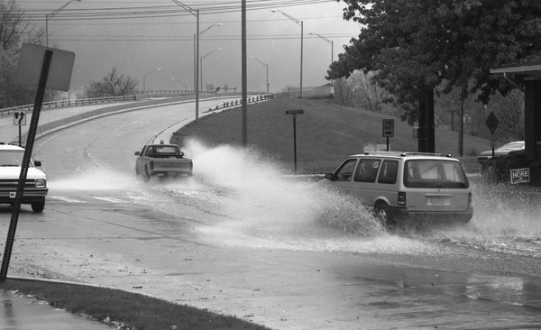 THE GOSHEN NEWS PHOTO  THE GOSHEN NEWS    OCT. 26, 1991<br /> Motorists driving south onto the overpass in Goshen had to slow down for puddles Friday as heavy rain quickly filled storm drains. There was 3.05 inches recorded at the Goshen College weather station, a record for that date. More rain is in the forecast.