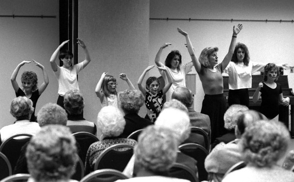 "THE GOSHEN NEWS PHOTO  BACK WHEN Dec. 8, 1989<br /> ""Five go-o-old rings!"" That's the line these dancers got caught interpreting during their Christmas recital Thursday at Greencroft Senior Center. The troupe of 7-to10-year-olds who take classes at Goshen YWCA Community Center were led by instructor Barbara Potuck, third from right. In addition to ""The Twelve Days of Christmas"" they performed to ""Nutcracker Dance"" and ""Country Music,"" and offered a little dance improvisation as well."