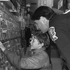 "THE GOSHEN NEWS PHOTO  THE GOSHEN NEWS | JAN. 14, 1994<br /> Goshen police detective Wade Branson helps Matt Tillotson, 13, find a Billy Ray Cyrus cassette tape Tuesday night at Wal-Mart on Lincolnway East as part of the ""Shop with a Cop"" program sponsored by the Franternal Order of Police No. 81 and local police departments. The program raises money to buy Christmas presents for needy children."