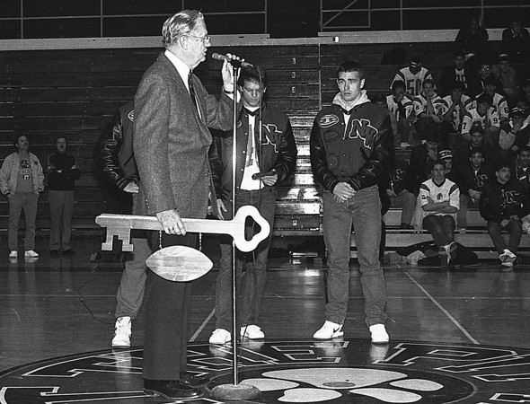 THE GOSHEN NEWS PHOTO  BACK WHEN Dec. 1, 1986<br /> Nappanee mayor Robert Callander presented a key to the city to the 1986 NorthWood High School football team at Sunday's welcome-home program at the school gym. Team captains Jeff Lengacher and Phil Wilson, right, are also shown. Wilson was recipient of the Phil Eakew mental attitude award at the state finals. Lengacher is holding an appreciation plaque from the town of Wakarusa, presented by Nick Kulp.