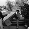 THE GOSHEN NEWS PHOTO  Back When March 14, 1984<br /> Moving day arrived this morning for workers int he Elkhart County Surveyor's office as the first phase of office transders to clear the site for the new county building project. Two employees of Bekin's Moving Company are shown carrying a desk from the surveyor's offices at 113 N. Third St. to the former Martin Law Office building at 119 N. Third St., now owned by the county. The entire project includes renovation of the Elkhart County jail and the construction of a new office building for county officials.